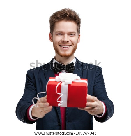 Man gives a present wrapped in red gift paper, isolated on white - stock photo