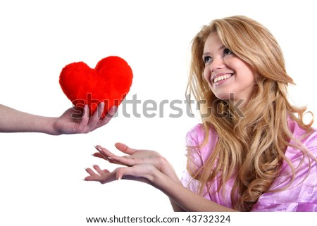 Man gives the girl's heart - stock photo