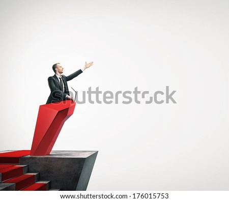 Man giving a speech with microphone - stock photo