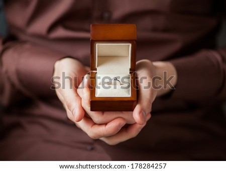 Man giving an engagement  box with ring - stock photo
