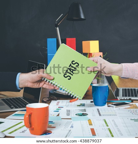 Man giving book which written Stats - stock photo