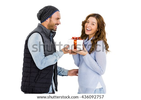 Man giving gift to woman on white background - stock photo