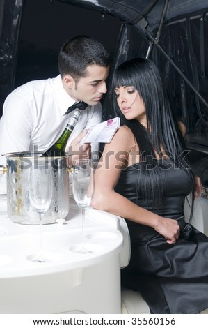 man giving money to a woman in a bar - stock photo