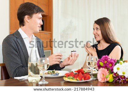 Man giving to girl the jewel box  at home - stock photo