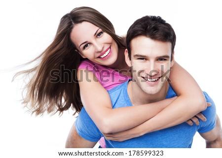 Man giving woman piggyback ride  - stock photo