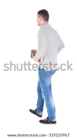 man goes and has a stack of books. back view. Rear view people collection.  backside view of person.  Isolated over white background. - stock photo