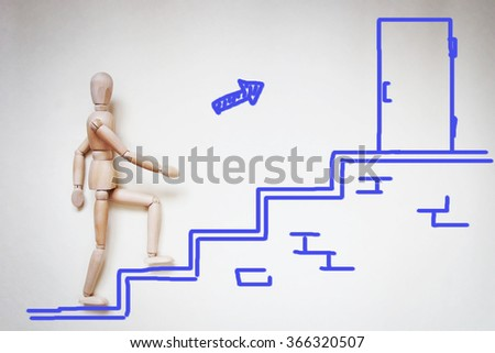 Man going upstairs to the door. Abstract image with a wooden puppet - stock photo