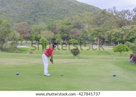 Man golfer ready to T- off  - stock photo