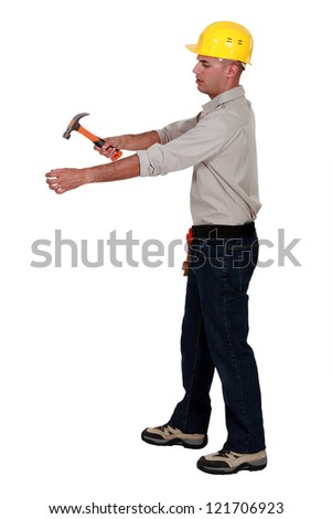 Man hammering an invisible object - stock photo