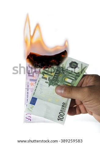 man hand holding a 500 euro and 100 euro notes burning on white background - stock photo