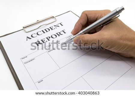 Man hand holding a pen, Car insurance form document  - stock photo