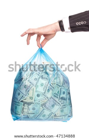 Man hand holding a plastic bag full of money - stock photo