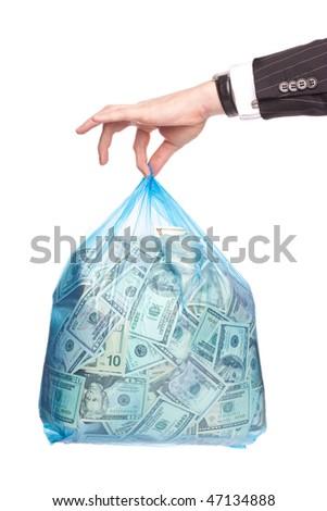 Man hand holding a plastic bag full of money - stock photo