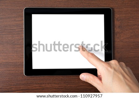 man hand holding a tablet touch computer gadget with a isolated screen with the background of the tree - stock photo