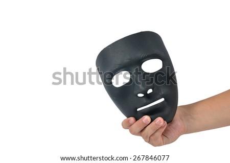 Man hand holding black mask, human behaviour - stock photo