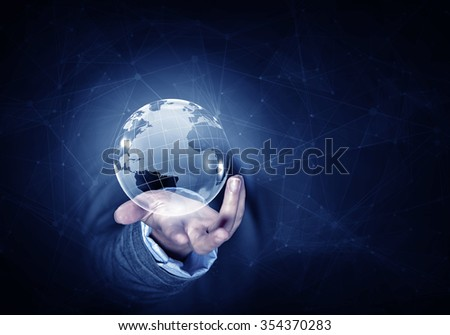 Man hand holding digital Earth planet representing global technologies concept - stock photo
