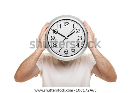 Man hand holding large office wall clock showing time isolated on white - stock photo