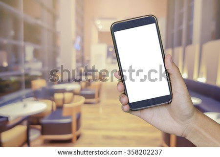 Man hand holding mobile smart phone , tablet,cellphone over blurred background of air hostess and  Stewart serves drinks out on board,vintage color,call service concept. - stock photo