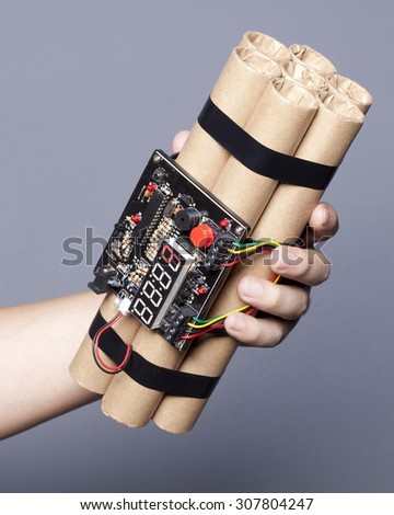 Man hand holding object ( Bomb )  - stock photo
