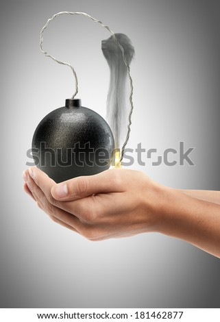 Man hand holding object ( Cannonball bomb ) High resolution  - stock photo