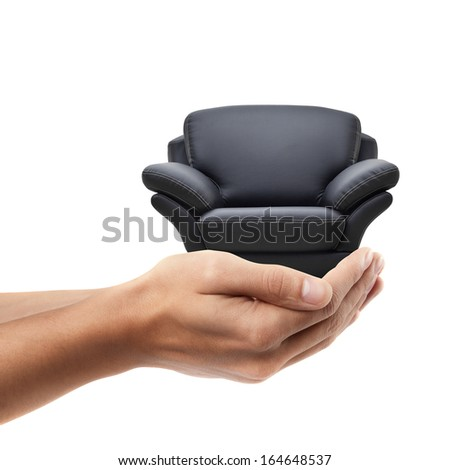 Man hand holding object ( modern leather chair )  isolated on white background. High resolution  - stock photo