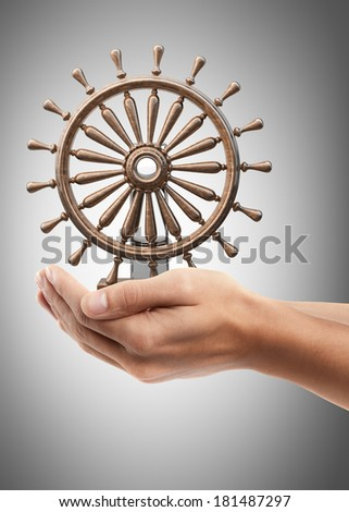 Man hand holding object ( wooden steering-wheel )  High resolution  - stock photo