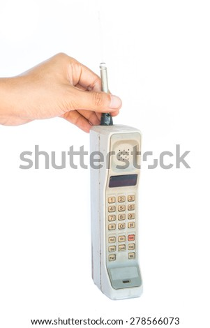 man hand holding vintage mobile phone Isolated on white background. - stock photo