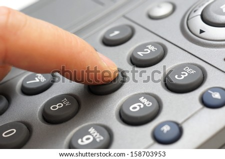 man hand is dialing a telephone number - stock photo