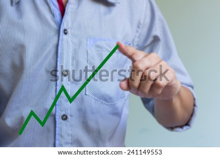 man hand is drawing a graph. - stock photo