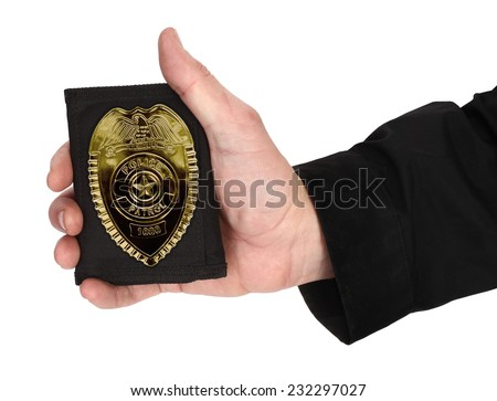 Man hand is holding police badge - stock photo