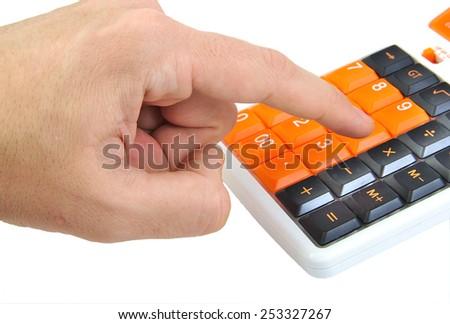Man hand making calculations on an orange calculator isolated on white background - stock photo