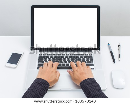 Man hand on laptop keyboard with blank screen monitor - stock photo