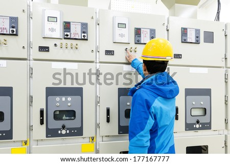 man hand pressing button - starting industrial process - stock photo