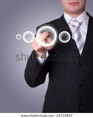 Man hand pressing media player button - stock photo