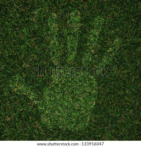 man hand print made of grass - stock photo