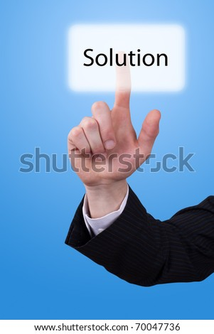 Man hand push on solution button - stock photo