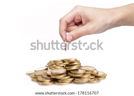 Man hand putting coin in stack, isolated on white background - stock photo