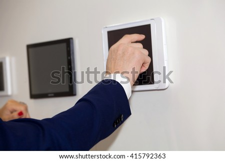 Man hand show on tablet screen close up view - stock photo