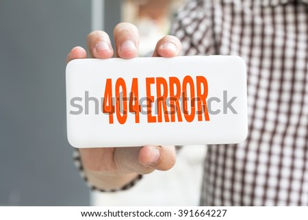 Man hand showing 404 ERROR word phone with  blur business man wearing plaid shirt. - stock photo