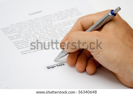 Man hand signing paper - stock photo