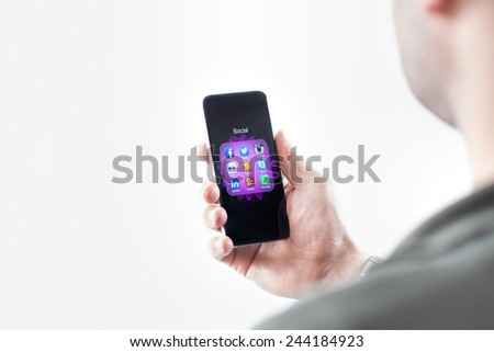 Man hand touching screen on modern mobile smart phone isolated on white background - stock photo