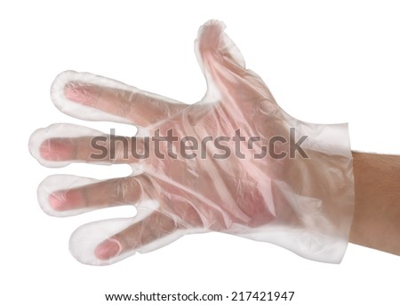 Man hand wearing disposable plastic glove - stock photo