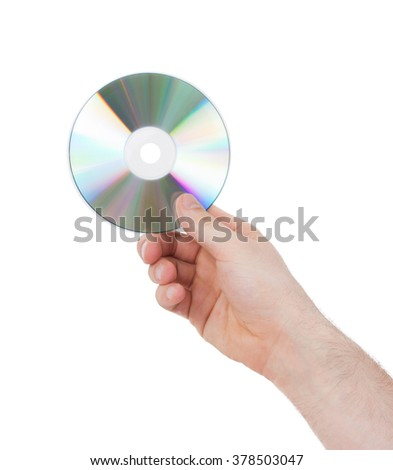 Man hand with compact disc isolated on white background - stock photo