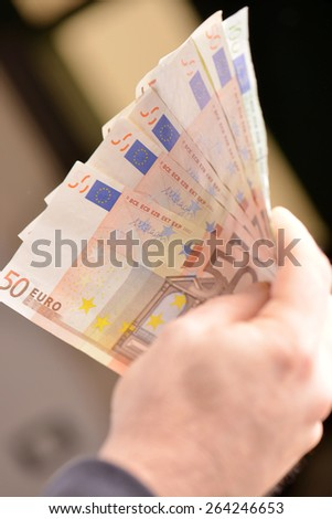 Man hand with euro - stock photo