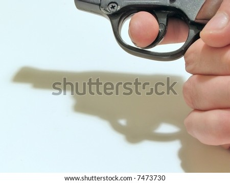 Man hand with gun and it`s shadow - stock photo