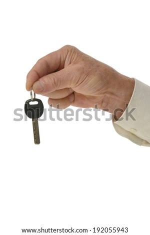 Man hand with keys isolated on white - stock photo