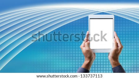 man hand work on tablet with green graphic background - stock photo