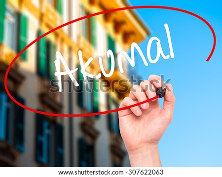 Man Hand writing Akumal with black marker on visual screen. Isolated on city. Business, technology, internet concept. Stock Photo - stock photo