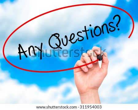 Man Hand writing Any Questions? with black marker on visual screen. Isolated on sky. Business, technology, internet concept. Stock Photo - stock photo