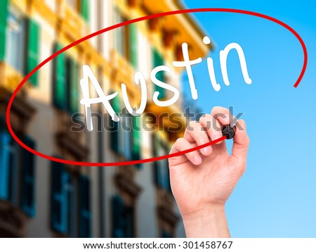 Man Hand writing Austin  with black marker on visual screen. Isolated on city. Business, technology, internet concept. Stock Photo - stock photo